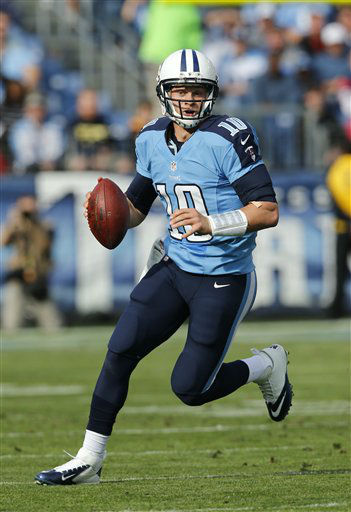 Tennessee Titans quarterback Jake Locker scrambles against the Houston Texans in the second quarter of an NFL football game on Sunday, Dec. 2, 2012, in Nashville, Tenn. &#40;AP Photo&#47;Joe Howell&#41; <span class=meta>(AP Photo&#47; Joe Howell)</span>