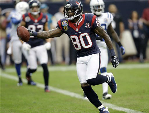 "<div class=""meta ""><span class=""caption-text "">Houston Texans wide receiver Andre Johnson (80) runs into the end zone for a touchdown after catching a pass against the Indianapolis Colts in the first quarter of an NFL football  game.  (AP Photo/ Eric Gay)</span></div>"