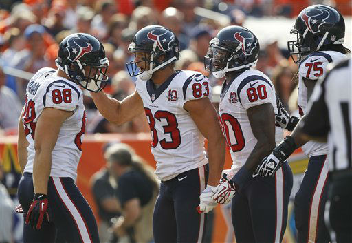 Houston Texans wide receiver Kevin Walter &#40;83&#41; celebrates with tight end Garrett Graham &#40;88&#41;, wide receiver Andre Johnson &#40;80&#41; and tackle Derek Newton &#40;75&#41; after catching a pass for a touchdown in the second quarter of an NFL football game against the Denver Broncos, Sunday, Sept. 23, 2012, in Denver. &#40;AP Photo&#47;David Zalubowski&#41; <span class=meta>(AP Photo&#47; David Zalubowski)</span>
