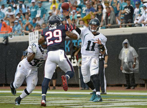 Jacksonville Jaguars quarterback Blaine Gabbert &#40;11&#41; throws a pass from his own end zone as Houston Texans strong safety Glover Quin &#40;29&#41; tries to block the ball during the first half an NFL football game, Sunday, Sept. 16, 2012, in Jacksonville, Fla. &#40;AP Photo&#47;Phelan M. Ebenhack&#41; <span class=meta>(AP Photo&#47; Phelan M. Ebenhack)</span>
