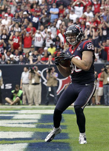 Houston Texans&#39; Garrett Graham scores against the Jacksonville Jaguars during the fourth quarter of an NFL football game Sunday, Nov. 18, 2012, in Houston.  <span class=meta>(AP Photo&#47; Patric Schneider)</span>