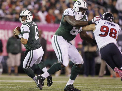 New York Jets quarterback Mark Sanchez looks to pass as tackle D&#39;Brickashaw Ferguson &#40;60&#41; blocks  Connor Barwin &#40;98&#41;during the first half of an NFL football game Monday, Oct. 8, 2012, in East Rutherford, N.J. &#40;AP Photo&#47;Kathy Willens&#41; <span class=meta>(AP Photo&#47; Kathy Willens)</span>