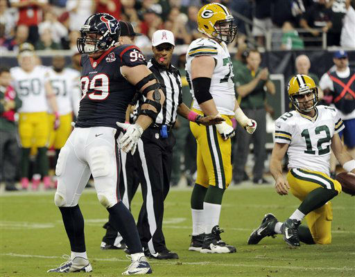 Houston Texans defensive end J.J. Watt &#40;99&#41; mimics Green Bay Packers quarterback Aaron Rodgers&#39; &#40;12&#41; celebration pose after sacking Rodgers in the first quarter of an NFL football game, Sunday, Oct. 14, 2012, in Houston. &#40;AP Photo&#47;Dave Einsel&#41; <span class=meta>(AP Photo&#47; Dave Einsel)</span>