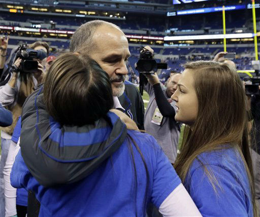 Indianapolis Colts head coach Chuck Pagano is greeted by family members after walking onto the field before an NFL football game against the Houston Texans, Sunday, Dec. 30, 2012, in Indianapolis. Pagano is back as coach after nearly three months of treatments for his leukemia.  &#40;AP Photo&#47;AJ Mast&#41; <span class=meta>(AP Photo&#47; AJ Mast)</span>