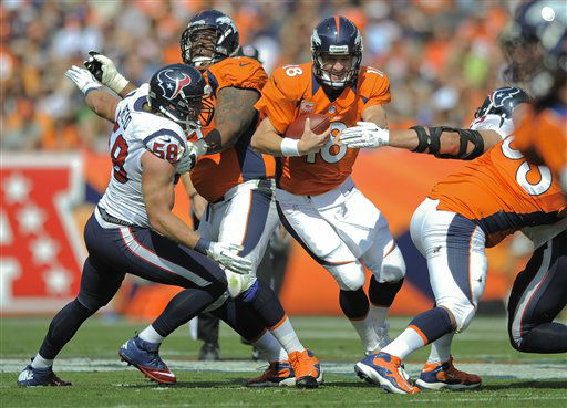 Denver Broncos quarterback Peyton Manning &#40;18&#41; runs the ball against Houston Texans outside linebacker Brooks Reed &#40;58&#41; in the second quarter of an NFL football game Sunday, Sept. 23, 2012, in Denver. &#40;AP Photo&#47;Jack Dempsey&#41; <span class=meta>(AP Photo&#47; Jack Dempsey)</span>