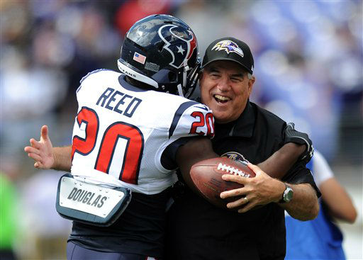 "<div class=""meta ""><span class=""caption-text "">Houston Texans free safety Ed Reed, left, hugs Baltimore Ravens defensive coordinator Dean Pees before an NFL football game Sunday, Sept. 22, 2013, in Baltimore. (AP Photo/Gail Burton)</span></div>"