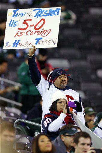 "<div class=""meta ""><span class=""caption-text "">Houston Texans fans watch their team warm up before an NFL football game against the New York Jets Monday, Oct. 8, 2012, in East Rutherford, N.J. (AP Photo/Julio Cortez) (AP Photo/ Julio Cortez)</span></div>"