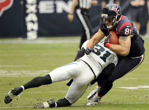 Houston Texans tight end Owen Daniels &#40;81&#41; is tackled by Jacksonville Jaguars&#39; Aaron Ross &#40;31&#41; during the first quarter of an NFL football game on Sunday, Nov. 18, 2012, in Houston.   <span class=meta>(AP Photo&#47; Dave Einsel)</span>