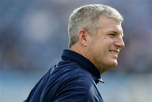Tennessee Titans head coach Mike Munchak watches his players warm up before an NFL football game between the Titans and the Houston Texans on Sunday, Dec. 2, 2012, in Nashville, Tenn. &#40;AP Photo&#47;Joe Howell&#41; <span class=meta>(AP Photo&#47; Joe Howell)</span>