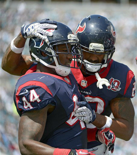 Houston Texans running back Ben Tate &#40;44&#41; congratulates Arian Foster after Foster scored a touchdown against the Jacksonville Jaguars during the first half of an NFL football game, Sunday, Sept. 16, 2012, in Jacksonville, Fla. <span class=meta>(AP Photo&#47; Phelan M. Ebenhack)</span>