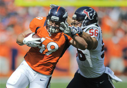 Denver Broncos running back Chris Gronkowski &#40;49&#41; is tackled by Houston Texans inside linebacker Brian Cushing &#40;56&#41; in the first quarter of an NFL football game Sunday, Sept. 23, 2012, in Denver. &#40;AP Photo&#47;Jack Dempsey&#41; <span class=meta>(AP Photo&#47; Jack Dempsey)</span>