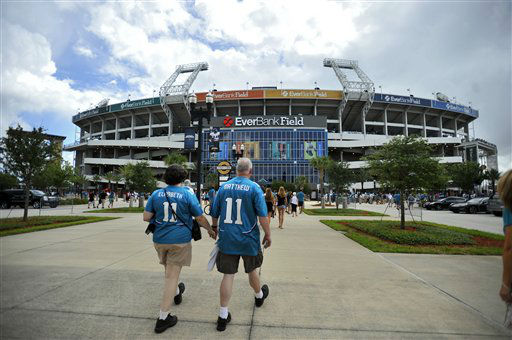 Two Jacksonville Jaguars fans walk to EverBank Field before an NFL preseason football game against the Houston Texans, Sunday, Sept. 16, 2012, in Jacksonville, Fla. &#40;AP Photo&#47;Stephen Morton&#41; <span class=meta>(AP Photo&#47; STEPHEN MORTON)</span>