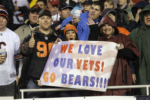"<div class=""meta ""><span class=""caption-text "">Fans hold up signs supporting our troops in the first half an NFL football game between the Chicago Bears and Houston Texans as part of the NFL's Salute to Service campaign on Veterans Day in Chicago, Sunday, Nov. 11, 2012.    (AP Photo/ Nam Y. Huh)</span></div>"