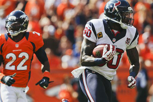 Houston Texans wide receiver Andre Johnson &#40;80&#41; catches a pass for a touchdown as Denver Broncos cornerback Tracy Porter &#40;22&#41; pursues in the first quarter of an NFL football game Sunday, Sept. 23, 2012, in Denver. &#40;AP Photo&#47;David Zalubowski&#41; <span class=meta>(AP Photo&#47; David Zalubowski)</span>