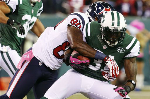 Houston Texans wide receiver Andre Johnson &#40;80&#41; tackles New York Jets cornerback Antonio Cromartie &#40;31&#41; after Cromartie intercepted a pass during the first half of an NFL football game, Monday, Oct. 8, 2012, in East Rutherford, N.J. &#40;AP Photo&#47;Julio Cortez&#41; <span class=meta>(AP Photo&#47; Julio Cortez)</span>