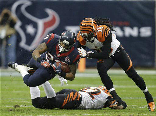 Houston Texans running back Arian Foster &#40;23&#41; is tackled by Cincinnati Bengals free safety Reggie Nelson &#40;20&#41; during the second quarter of an NFL wild card playoff football game Saturday, Jan. 5, 2013, in Houston. Cincinnati Bengals strong safety Nate Clements is underneath Foster. &#40;AP Photo&#47;Eric Gay&#41; <span class=meta>(AP Photo&#47; Eric Gay)</span>