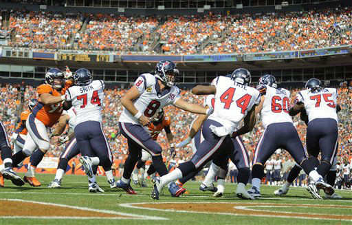 Houston Texans quarterback Matt Schaub &#40;8&#41; hands off the ball to Houston Texans running back Ben Tate &#40;44&#41; in the first quarter of an NFL football game against the Denver Broncos, Sunday, Sept. 23, 2012, in Denver. &#40;AP Photo&#47;Jack Dempsey&#41; <span class=meta>(AP Photo&#47; Jack Dempsey)</span>