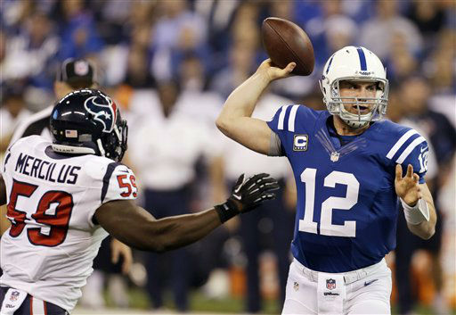 Indianapolis Colts&#39; Andrew Luck &#40;12&#41; throws while pressured by Houston Texans&#39; Whitney Mercilus &#40;59&#41; during the first half of an NFL football game on Sunday, Dec. 30, 2012, in Indianapolis. &#40;AP Photo&#47;Darron Cummings&#41; <span class=meta>(AP Photo&#47; Darron Cummings)</span>