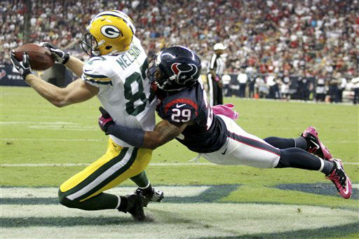 Green Bay Packers wide receiver Jordy Nelson &#40;87&#41; makes a catch to score a touchdown against Houston Texans strong safety Glover Quin &#40;29&#41; in the third quarter of an NFL football game, Sunday, Oct. 14, 2012, in Houston. &#40;AP Photo&#47;Patric Schneider&#41; <span class=meta>(AP Photo&#47; Patric Schneider)</span>