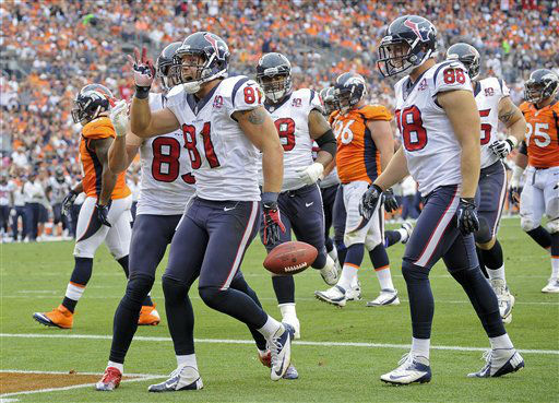 Houston Texans tight end Owen Daniels &#40;81&#41; celebrates with wide receiver Kevin Walter &#40;83&#41;, outside linebacker Connor Barwin &#40;98&#41; and tackle Ryan Harris &#40;68&#41; after scoring a touchdown in the third quarter of an NFL football game Sunday, Sept. 23, 2012, in Denver. &#40;AP Photo&#47;Jack Dempsey&#41; <span class=meta>(AP Photo&#47; Jack Dempsey)</span>