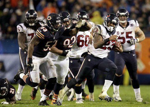 Houston Texans running back Arian Foster &#40;23&#41; rushes past Chicago Bears linebacker Nick Roach &#40;53&#41; and defensive tackle Stephen Paea &#40;92&#41; during the first half an NFL football game, Sunday, Nov. 11, 2012, in Chicago. &#40;AP Photo&#47;Nam Y. Huh&#41; <span class=meta>(AP Photo&#47; Nam Y. Huh)</span>