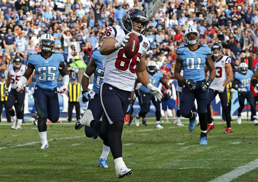 Houston Texans fullback James Casey (86) scores a touchdown on a 5-yard pass reception against the Tennessee Titans in the first quarter of an NFL football game on Sunday, Dec. 2, 2012, in Nashville, Tenn. (AP Photo/Joe Howell)