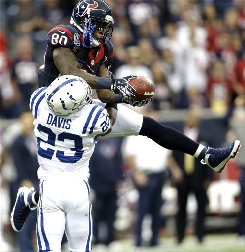 Houston Texans wide receiver Andre Johnson &#40;80&#41; catches a pass for a first down as Indianapolis Colts cornerback Vontae Davis &#40;23&#41; defends before an NFL football game Sunday, Dec. 16, 2012, in Houston. &#40;AP Photo&#47;Eric Gay&#41; <span class=meta>(AP Photo&#47; Eric Gay)</span>
