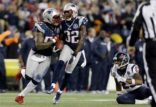 "<div class=""meta image-caption""><div class=""origin-logo origin-image ""><span></span></div><span class=""caption-text"">New England Patriots free safety Devin McCourty (32) celebrates his interception with middle linebacker Brandon Spikes (55) as Houston Texans running back Arian Foster (23) sits on the turf during the first quarter of an NFL football game in Foxborough, Mass., Monday, Dec. 10, 2012. (AP Photo/Elise Amendola) (AP Photo/ Elise Amendola)</span></div>"