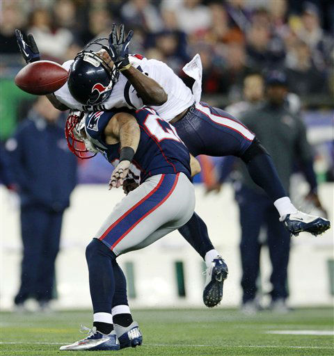 New England Patriots strong safety Steve Gregory &#40;28&#41; breaks up a pass intended for Houston Texans wide receiver Lestar Jean, top, during the second quarter of an NFL football game in Foxborough, Mass., Monday, Dec. 10, 2012. &#40;AP Photo&#47;Steven Senne&#41; <span class=meta>(AP Photo&#47; Steven Senne)</span>