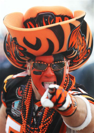 Cincinnati Bengals fan Shawn Moore makes his way into the stadium before an NFL wild card playoff football game against the Houston Texans Saturday, Jan. 5, 2013, in Houston. (AP Photo/Patric Schneider)