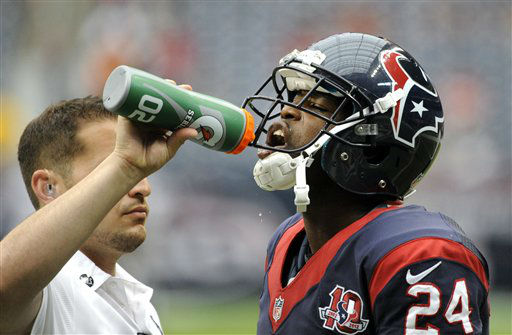 Houston Texans cornerback Johnathan Joseph &#40;24&#41; takes a drink before an NFL football game against the Minnesota Vikings Sunday, Dec. 23, 2012, in Houston. &#40;AP Photo&#47;Dave Einsel&#41; <span class=meta>(AP Photo&#47; Dave Einsel)</span>