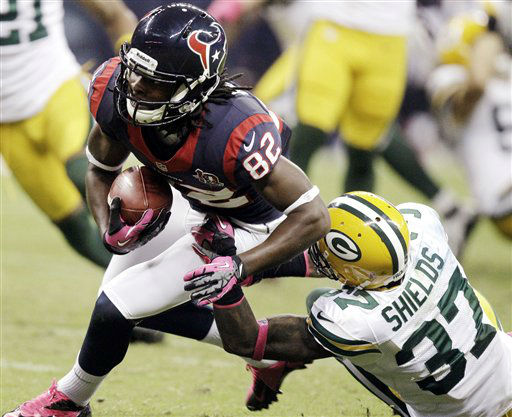 "<div class=""meta ""><span class=""caption-text "">Green Bay Packers cornerback Sam Shields (37) gets a hold on Houston Texans wide receiver Keshawn Martin (82) in the third quarter of an NFL football game, Sunday, Oct. 14, 2012, in Houston. (AP Photo/Patric Schneider) (AP Photo/ Patric Schneider)</span></div>"