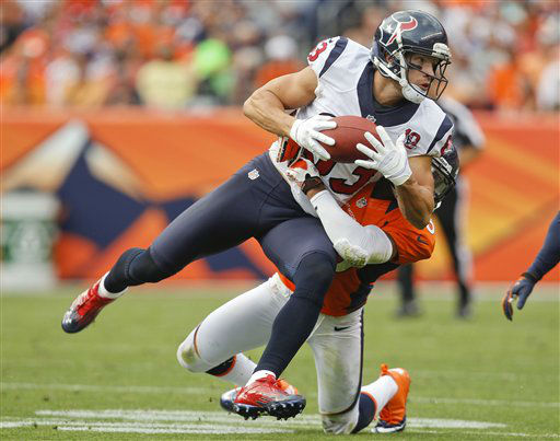 Houston Texans wide receiver Kevin Walter &#40;83&#41; brings down a pass as he is hit by Denver Broncos strong safety Chris Harris &#40;25&#41; in the fourth quarter of an NFL football game Sunday, Sept. 23, 2012, in Denver. &#40;AP Photo&#47;David Zalubowski&#41; <span class=meta>(AP Photo&#47; David Zalubowski)</span>