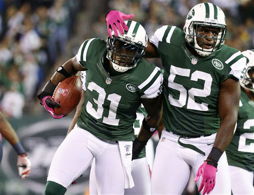 New York Jets cornerback Antonio Cromartie &#40;31&#41; celebrates with linebacker David Harris &#40;52&#41; after intercepting a pass during the first half of an NFL football game against the Houston Texans, Monday, Oct. 8, 2012, in East Rutherford, N.J. &#40;AP Photo&#47;Julio Cortez&#41; <span class=meta>(AP Photo&#47; Julio Cortez)</span>