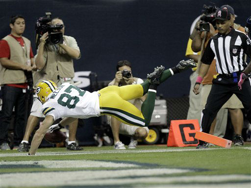 Green Bay Packers wide receiver Jordy Nelson, left, falls into the end zone for a touchdown against the Houston Texans in the first quarter of an NFL football game Sunday, Oct. 14, 2012 in Houston. &#40;AP Photo&#47;Patric Schneider&#41; <span class=meta>(AP Photo&#47; Patric Schneider)</span>