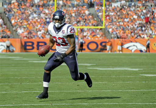 Houston Texans running back Arian Foster &#40;23&#41; runs for a touchdown against the Denver Broncos in the first quarter of an NFL football game Sunday, Sept. 23, 2012, in Denver. &#40;AP Photo&#47;Jack Dempsey&#41; <span class=meta>(AP Photo&#47; Jack Dempsey)</span>