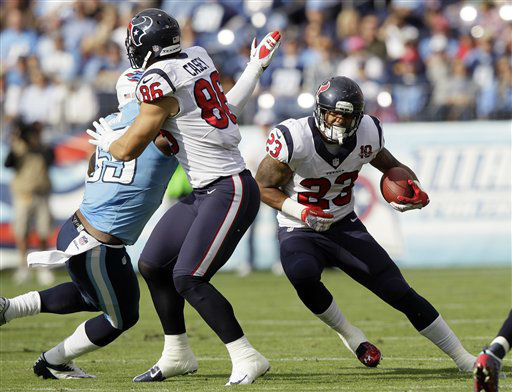 Houston Texans running back Arian Foster &#40;23&#41; runs as fullback James Casey &#40;86&#41; blocks Tennessee Titans linebacker Zach Brown &#40;55&#41; in the first quarter of an NFL football game on Sunday, Dec. 2, 2012, in Nashville, Tenn.  <span class=meta>(AP Photo&#47; Wade Payne)</span>