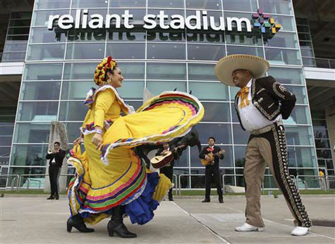 "<div class=""meta ""><span class=""caption-text "">Mariachis and dancers perform outside Reliant Stadium before an NFL football game between the Houston Texans and the Tennessee Titans Sunday, Sept. 30, 2012, in Houston. (AP Photo/Patric Schneider) (Photo/Patric Schneider)</span></div>"