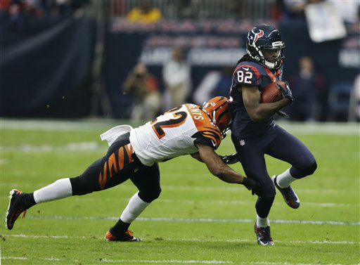 Houston Texans wide receiver Keshawn Martin &#40;82&#41; is defended by Cincinnati Bengals strong safety Nate Clements &#40;22&#41; during the first quarter of an NFL wild card playoff football game Saturday, Jan. 5, 2013, in Houston. &#40;AP Photo&#47;Eric Gay&#41; <span class=meta>(AP Photo&#47; Eric Gay)</span>