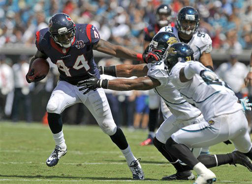 Houston Texans running back Ben Tate &#40;44&#41; gets around the Jacksonville Jaguars defense, including cornerback Aaron Ross, right, before running out of bounds during the first half an NFL football game on Sunday, Sept. 16, 2012, in Jacksonville, Fla. &#40;AP Photo&#47;Stephen Morton&#41; <span class=meta>(AP Photo&#47; Stephen Morton)</span>