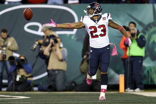 Houston Texans running back Arian Foster &#40;23&#41; celebrates after rushing for a touchdown during the first half of an NFL football game against the New York Jets Monday, Oct. 8, 2012, in East Rutherford, N.J. &#40;AP Photo&#47;Julio Cortez&#41; <span class=meta>(AP Photo&#47; Julio Cortez)</span>