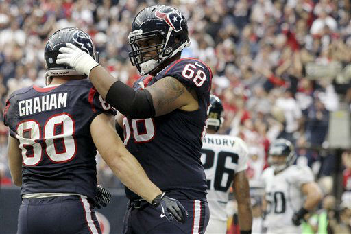 Houston Texans&#39; Ryan Harris &#40;68&#41; congratulates Garrett Graham &#40;88&#41; on a touchdown against the Jacksonville Jaguars during the fourth quarter of an NFL football game, Sunday, Nov. 18, 2012, in Houston. &#40;AP Photo&#47;Patric Schneider&#41; <span class=meta>(AP Photo&#47; Patric Schneider)</span>