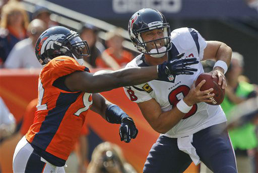Denver Broncos defensive end Elvis Dumervil &#40;92&#41; sacks Houston Texans quarterback Matt Schaub &#40;8&#41; in the endzone for a safety during the first quarter of an NFL football game Sunday, Sept. 23, 2012, in Denver. &#40;AP Photo&#47;David Zalubowski&#41; <span class=meta>(AP Photo&#47; David Zalubowski)</span>