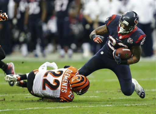 Houston Texans running back Arian Foster &#40;23&#41; is tackled by Cincinnati Bengals strong safety Nate Clements &#40;22&#41; during the second quarter of an NFL wild card playoff football game Saturday, Jan. 5, 2013, in Houston. &#40;AP Photo&#47;Eric Gay&#41; <span class=meta>(AP Photo&#47; Eric Gay)</span>