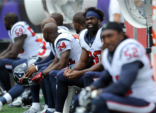 "<div class=""meta ""><span class=""caption-text ""> Houston Texans free safety Ed Reed, second from right, looks on from the sideline before an NFL football game against the Baltimore Ravens Sunday, Sept. 22, 2013, in Baltimore.  (AP Photo/Gail Burton)</span></div>"