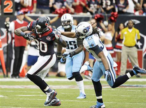 Houston Texans wide receiver Andre Johnson &#40;80&#41; breaks away from Tennessee Titans  Michael Griffin &#40;33&#41; and  Akeem Ayers &#40;56&#41; in the first quarter of an NFL football game Sunday, Sept. 30, 2012, in Houston. &#40;AP Photo&#47;Dave Einsel&#41; <span class=meta>(Photo&#47;Pat Sullivan)</span>