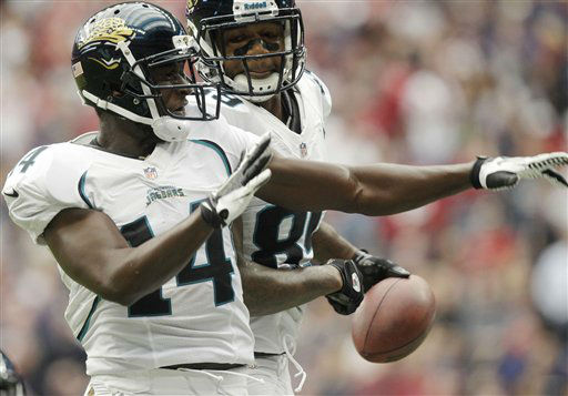 Jacksonville Jaguars Justin Blackmon &#40;14&#41; and Marcedes Lewis &#40;89&#41; celebrate a touchdown against the Houston Texans during the first quarter of an NFL football game Sunday, Nov. 18, 2012, in Houston. &#40;AP Photo&#47;Patric Schneider&#41; <span class=meta>(AP Photo&#47; Patric Schneider)</span>