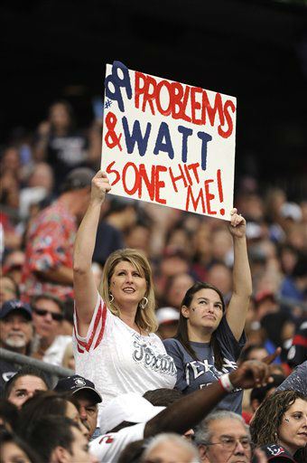 Houston Texans fans hold up a sign in the second quarter of an NFL football game against the Buffalo Bills Sunday, Nov. 4, 2012, in Houston. &#40;AP Photo&#47;Dave Einsel&#41; <span class=meta>(AP Photo&#47; Dave Einsel)</span>