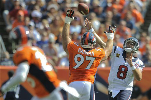 Houston Texans quarterback Matt Schaub &#40;8&#41; throws over Denver Broncos defensive tackle Justin Bannan &#40;97&#41; for a touchdown in the first quarter of an NFL football game Sunday, Sept. 23, 2012, in Denver. &#40;AP Photo&#47;Jack Dempsey&#41; <span class=meta>(AP Photo&#47; Jack Dempsey)</span>