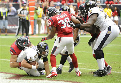 Houston Texans outside linebacker Connor Barwin &#40;98&#41; scores a safety on Baltimore Ravens quarterback Joe Flacco &#40;5&#41; during the first quarter of an NFL football game Sunday, Oct. 21, 2012, in Houston. &#40;AP Photo&#47;Dave Einsel&#41; <span class=meta>(AP Photo&#47; Dave Einsel)</span>